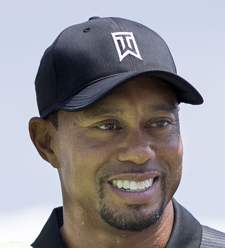 450px-Tiger_Woods_with_a_fan_2014_cr